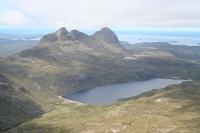 Suilven's full glory is revealed when viewed from one of the surrounding mountains.
